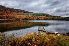 11/3/16 Mountain Lake (Karol A Olson) Tags: amherstlake ludlow vermont mountain trees fall autumn dock clouds reflection water lake nov16 project3662016