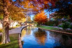 Bricktown Stroll (Calpastor) Tags: okc oklahoma travel bricktown thunder i40 city romance fall walk water path trees reflection