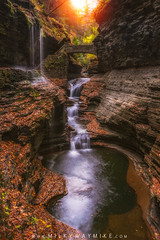 Rainbow Falls at Watkins Glen (Mike Ver Sprill - Milky Way Mike) Tags: watkinsglenstatepark fingerlakesstatepark upstatenewyork rainbowfalls waterfall sunglow fallfoliage autumn seasonschanging rocks gorgetrail bridge leaves trees forest michaelversprill mikeversprill milkywaymike hikewithmike nikond800 travel explore places beautiful amazing surreal serene relaxing peaceful gothere landscape nature