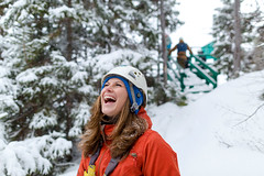 Winter Ziplining (Newfoundland and Labrador Tourism) Tags: western winter snow ziplining zip lining fun girl person smiling smile laughing laugh helmet red coat trees marble mountain tours