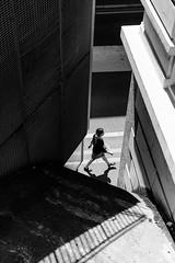She (Julien.Belli) Tags: she street city light shadow people urban blackandwhite bw woman sun white house black building slr art girl monochrome lines wall 35mm buildings dark walking concrete person photography one schweiz switzerland photo reflex nikon women day photographie suisse 7100 d walk center line lausanne diagonal sidewalk mm moment dslr svizzera 35 rue ville flon romandie d7100