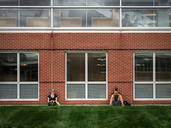 Passing the time (.Chris Lee) Tags: school windows people brick college apple window students glass grass mobile wall campus outside outdoors reading book education midwest sitting technology phone bricks cellphone iowa smartphone cap sit tablet ios collegestudents iphone 5s appleiphone iphonephotography iphonography iphone5s appleiphone5s