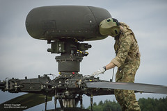 An Apache attack helicopter pilot of 4 REGT AAC inspects his aircraft while he awaits tasking. (Defence Images) Tags: 4regtaac 4thregiment armyaircorps ah1d apache attack helicopter aircraft equipment army international training britishairborneforcesbritishairborneforces exerciseswiftresponse german french american jointforce nato interoperability anapg78longbowradar defence free defense uk british military hohenfels bavaria germany
