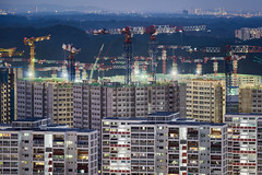 Multitudes (Scintt) Tags: singapore bukit batok cityscape city sky clouds long exposure slow shutter night evening apartments construction cranes building architecture high rise flats vanatage point tele telephoto travel urban exploration glow light cluttered patterns texture housing hdb public homes surreal scintillation scintt jon chiang photography