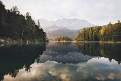 Golden mornings at lake Eibsee. (Bokehm0n) Tags: landscape nature vsco explore flickr earth travel folk 500px vscofilm germany water lake reflection river tree mountain wood outdoors dawn scenic sky fog sunset valley light sunrise