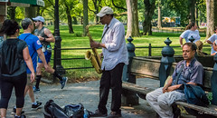 2016 - New York City - Central Park - 6 of 11 (Ted's photos - Returns late November) Tags: 2016 cropped nikon nikond750 nikonfx nyc newyorkcity tedmcgrath tedsphotos vignetting centralparkmall centralpark centralparknyc nyccentralpark themall centralparkthemall themallcentralpark musician busker seating seated sitting entertainer saxophone sax blowing runner ballcap fencing backpack people peopleandpaths bench