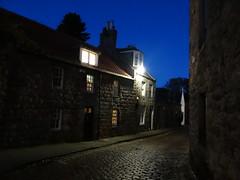 Aberdeen at Night ( Blue Night ) (Ian Jackson 1974) Tags: night oldaberdeen pavement houses lights windows cobbles lane dusk darkness oldhouses bluenight november evening aberdeen scottisharchitecture roof door