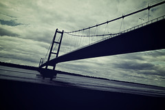 July 25 : 030 x Humber Bridge (moggsterb) Tags: 100xthe2016edition 100x2016 image30100 u humber humberbridge monochrome blue clouds riverbank eastyorkshire span road cables tower travel contrast river estuary tide