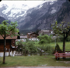 img166 (foundin_a_attic) Tags: switzerland july 1975 houses s chalet swiss bench tree snow mountians ice peak grass mountain grindew wald