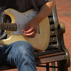 Strum (swong95765) Tags: strumming picking electric bench man guy jeans guitar instrument pick