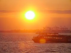 Winter Sunset on the Shuttle to Manhattan (Ye Jin) Tags: manhattan sunset sea warm winter boat water yellow orange shuttle cloud panasonic g3 m43