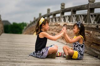 Kids on a wood bridge