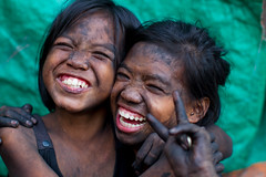 Smiling Charcoal Girls (AdamCohn) Tags: poverty girl smile child coins smoke philippines poor dirty charcoal laugh manila change filipina smoky coal collecting collector scavenger scavenging smokeymountain tondo adamcohn wwwadamcohncom