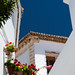 https://www.twin-loc.fr Small street with flowers and blue sky in Alhama de Granada, Andalousia, Spain - Picture Image Photography
