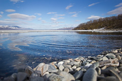 travel14_SWE_008 (MIKADM) Tags: blue summer sky sun reflection beach wet strand silver circle season waterfall droplets rocks europe raw sweden stones north eu peaceful falls arctic lapland midnight serene ripples sverige eurotrip splash scandinavia northern skipping abisko 2014 swe northernsweden landofthemidnightsun silverfallet tornetrask