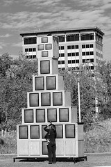The Photographer and The Stack (from the archives) (basselal) Tags: camera blackandwhite bw woman art monochrome tv downtown texas photographer streetphotography houston stack canonef50mmf18ii discoverygreen
