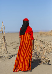 Afar Tribe Woman Wearing A Burqa, Assayta, Ethiopia (Eric Lafforgue) Tags: africa portrait people orange black beauty vertical horizontal scarf outdoors photography women day adult african islam faith religion headscarf hijab tribal beautifulwoman shawl tradition ethiopia tribe adultsonly anthropology oneperson hornofafrica ethiopian afar covering humaneye burka socialissues traditionalclothing 2025years onewomanonly lookingatcamera fulllenght colorpicture oneyoungwomanonly danakil colourimage africanethnicity 1people africanculture onlywomen colourpicture assaita asaita humanbodypart assayta religiousdress oneteenageronly oneyoungadultonly ethio1407058