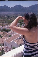 Spain 2016 - Retinette (Little Freak 2) - Jalon Valley - Lisa on the balcony (TempusVolat) Tags: curved curvy holiday spainholiday spain 2016 vacance summer gareth wonfor tempus volat mrmorodo tempusvolat garethwonfor kodak retinette vintagecamera film 35mm scan scanned scanning scanner epson perfection v200 wife lisa girl woman holidaysnaps negative beauty beautiful brunette beautifulwife beautifulwoman prettywife attractive pretty lovelywife mywife mygirl gorgeouswife lovelylisa prettylisa goodlooking goodlooks spouse lover lovely love allure mole tummy boobs voluptuous boob breast breasts demure shapely curvaceous boobtube sexy shorts shortpants short