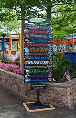 You Really Get Around- vertical (Michiale Schneider) Tags: sign putinbay southbassisland ohio youreallygetaround colorful metal