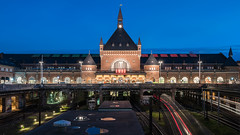 Copenhagen Central (McQuaide Photography) Tags: copenhagen kbenhavn denmark danmark danish scandinavia europe sony a7rii ilce7rm2 alpha mirrorless 1635mm sonyzeiss zeiss variotessar fullframe mcquaidephotography adobe photoshop lightroom tripod manfrotto light lowlight dusk bluehour twilight longexposure city capitalcity urban architecture building outdoor outside capitalregionofdenmark regionhovedstaden reflection puddle station centralstation railway rail train tracks transport transportation publictransport lighttrails kbenhavnshovedbanegrd kbenhavnh vesterbrogade heinrichwenck dsb danskestatsbaner danishstaterailways entrance front facade clocktower 169 widescreen panoramic