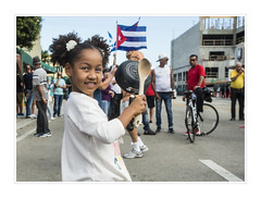 Cazuelita (fotoJENica) Tags: littlegirl cuban celebration street party littlehavana miami florida calleocho fidelcastrodies partying cuba flags potsandpans