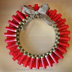 1086 of 1096 (yr 3) - Red neck Christmas wreath (Hi, I'm Tim Large) Tags: christmas wreath shotgun shells cartridges empty used fired red fuji fujinon fujifilm x70 circle bow redneck gun shooter