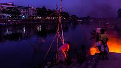 Fishing (mithila909) Tags: streetphotography urban people fishing net fishingnet fire river jetty building bridge