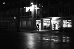 The man on the small bike (pascalcolin1) Tags: paris13 nuit nigft vlo bike homme man lumire light reflets reflection vitrine windows pluie rain photoderue streetview urbanarte noiretblanc blackandwhite photopascalcolin