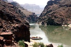 35-820 (ndpa / s. lundeen, archivist) Tags: nick dewolf nickdewolf color photographbynickdewolf 1970s 1973 1972 film 35mm 35 reel35 arizona northernarizona southwesternunitedstates canyon marblecanyon grandcanyon coloradoriver raftingtrip raftingexpedition rafting river riverrafting rock rocks rocky landscape canyonwall canyonwalls cliff cliffs raft rafts inflatable inflatables people lifejackets lifepreservers floatationdevices beached sanderson sandersonraftingexpeditions sandersonriverexpeditions srig