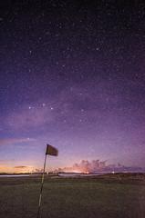 18th Hole (Glen Parry Photography) Tags: golf nikon night nightphotography nightsky stars northumberland glenparryphotography d7000 longexposure nightscape sigma sigma1020mm flag landscape dunstanburghcastle ocean rocks sea seascape