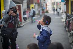 catching a soap bubble boy (kasa51) Tags: people street boy child soapbubble alley photographer chinatown yokohama japan nikkorsauto50mmf14