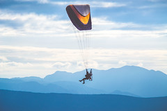 Paragliding with motor (Akis TzeStarr) Tags: outdoor sport motor paraglide nikon d3100 zoomlens 150mm greece ioannina ligiades 15km mountainshoot blue sky mountains parachute fly abovetheclouds clouds