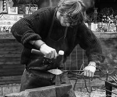Prague Blacksmith (manxmaid2000) Tags: blackandwhite bw heritage metal hammer work mono blackwhite czech prague traditional craft praha smith apron blacksmith craftsman artisan anvil skill