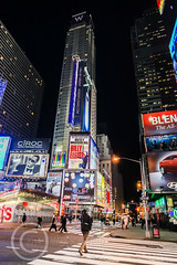 New York Jan2010 907 (Mark Schofield @ JB Schofield) Tags: street city nyc woman newyork tourism yellow america skyscraper crossing pavement path candid cab united empirestatebuilding states manhatten americanarchitecture