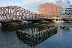 Boat Crossing Old Northern Avenue (The Flying Inn) Tags: old city bridge water boston ferry docks buildings harbor boat fishing ships ave transportation wharf avenue northern rowes fortpointchannel roweswharf harborwalk oldnorthernavenuebridge massachusettsbostonharbor infinitexposure