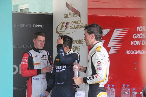 Mitch Evans, Jolyon Palmer and Soffel Vandoorne prepare for the podium after the first GP2 race at the 2014 German Grand Prix