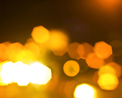golden bokeh (MileIQ) Tags: street city light urban holiday abstract blur art cars yellow closeup sparkles night dark festive lens outdoors gold lights golden evening design blurry shiny warm nightly glare shine traffic mask blind bright artistic random bokeh dusk many background grunge creative illumination lot balls bubbles blurred ornament blisters glowing headlight rushhour lamps concept conceptual luminous brilliant sparkling automobiles flares particles brilliance chaotic defocused diaphragm