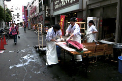 Surgery (Dance with the Strangers) Tags: pink red people white fish color colour japanese tokyo photographer 28mm streetphotography documentary surgery tuna ricoh 2014 candidportrait thunnus tokyocity urbanasia grd4