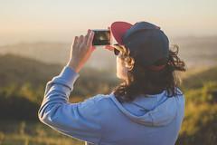 Viktor (Audentis fortuna iuvat.) Tags: sunset light sunlight sun snapback chile canon canonchile chilean contrast colors 50mm cellphone portrait hair longhair