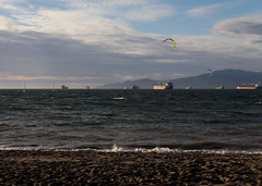 Ships & Kiteboarders (TheOtter) Tags: vancouver beach boat cargo city clouds ocean sand ship shoreline sports urban water
