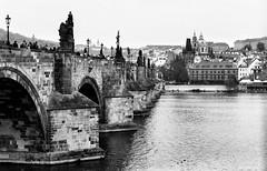 Charles Bridge (Jakub Skořepa) Tags: city czech czechrepublic oldcity citycenter praguecity prague river winter architecture retro old nikon nikonf3 nikoncamera voigtlander nokton outdoor statue