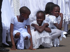 Taking a rest (prondis_in_kenya) Tags: kenya nairobi shortrains holyfamily basilica church cathedral catholic uniform uniformedservices thanksgiving firstcommunion white dress