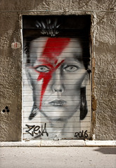 Tribute to David Bowie (hogsvilleBrit) Tags: bowie davidbowie door art trapani sicily ziggy ziggystardust face stripe red eyes cmwd cmwdred 9 number9