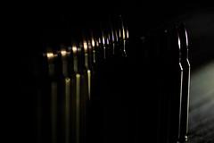 Modern Arrow (niKonJunKy22) Tags: macromondays mondays arrow row inarow indoor inthemirror mirror bullets bullet focus blurry blur black dark darkness points point 556 rownd cartridge copper brass fullmetaljacket shelf light rounds guns ammo hmm d700 nikkor28300 nikon nikkor modern dof depthoffield depth defense