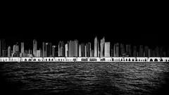 ...thecity... (*ines_maria) Tags: panasonicdmcgx8 dubai uae seascape skyline sea persiangulf seaview black sky blacksky light contrast bw blackandwhite blancetnoire mono monochrome urbanart urban ciy panorama panoramavie