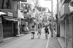 steadily (edwardpalmquist) Tags: takeshitastreet harajuku shibuya tokyo japan blackandwhite monochrome people girl fashion graffiti outdoors architecture road