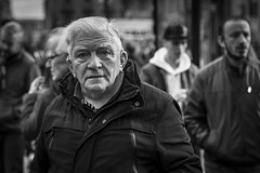 A Face In The Crowd (Leanne Boulton) Tags: people monochrome depthoffield outdoor urban street candid portrait portraiture streetphotography candidstreetphotography candidportrait streetlife eyecontact candideyecontact old age aged elderly handsome man male beauty face facial expression look emotion feeling mood eyes atmosphere busy chaotic tone texture detail bokeh natural light shade shadow city scene human life living humanity society culture canon 5d canon5dmkiii 70mm character ef2470mmf28liiusm bw black white blackwhite mono blackandwhite glasgow scotland uk