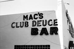 Macs Club Deuce Bar Sign (Phillip Pessar) Tags: from camera bw white black film beach sign bar club analog 35mm store florida zoom kodak miami infinity tx south trix olympus x thrift 400 tri 70 macs deuce sobe