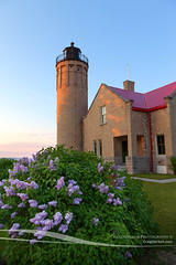 Lilacs in Bloom at Old Mackinac Point Lighthouse (Craig - S) Tags: statepark travel vacation horses usa lighthouse tourism america island midwest carriage michigan resort greatlakes prints destination americana familyfun upnorth upperpeninsula buggy lilacfestival mackinacisland lilacs mackinacbridge mackinac stockphoto grandhotel horseandcarriage mackinaw horseandbuggy stockphotography uppermichigan canvases northernmichigan fortmackinac fineartprint michiganstateparks mackinacislandstatepark puremichigan topmidwestresort midwestresort
