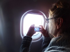 French Lady Photographing Greenland (mercycube) Tags: london greenland glaciers icebergs virginatlantic frenchwoman